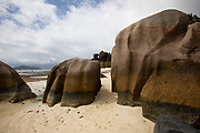 Eroded granite. The action of waves over countless millennia has shaped the hard granite into these sculpted formations. This is the tropical island of La Digue, part of the Seychelles islands of the Indian Ocean. The Seychelles islands formed some 200 million years ago when India and Madagascar split off from Africa. They are unique as the only granite islands in the world, as well as being the oldest islands in the world. Many such sculpted granite boulders and outcrops are found along the beaches of the Seychelles.