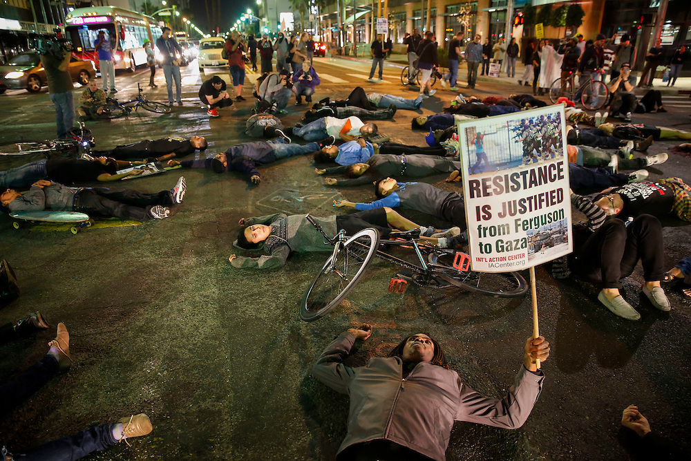 Protestors block the street at Wilshire and La Brea.<br /> People protest the decision of the Ferguson grand jury and the death of Michael Brown on  Monday, November 24, 2014 in Beverly HIlls, Calif. (Patrick T. Fallon/ For the Los Angeles Times)