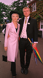 Socialite MISS TAMARA BECKWITH and MR RICHARD WALL at Royal Ascot on 18th June 1998.MIN 101