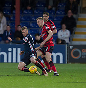 8th May 2018, Global Energy Stadium, Dingwall, Scotland; Scottish Premiership football, Ross County versus Dundee; Billy McKay of Ross County battles for the ball with Kevin Holt of Dundee