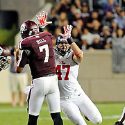 Mississippi defensive end John Youngblood (47) pressures Mississippi running back Mark Dodson (7) during the second half of an NCAA college football game in College Station, Texas, Saturday, Oct. 11, 2014. No. 3 Mississippi won 35-20. (Photo/Thomas Graning)