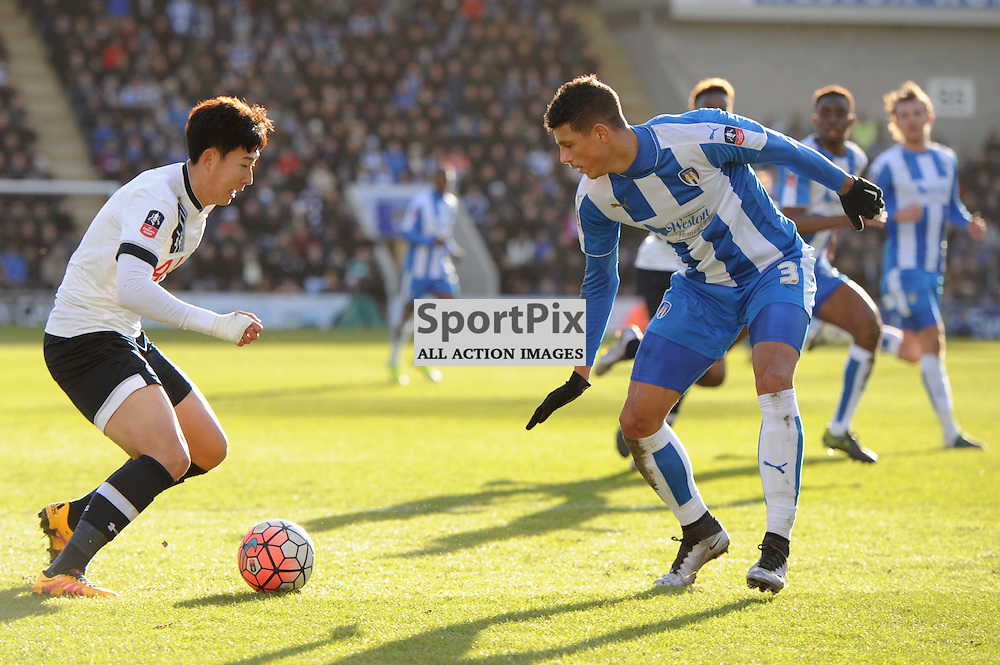 Colchesters Matt Briggs and Tottenhams Heung-Min Son in action during the Colchester v Tottenham game in the FA Cup 4th Round on the 30th January 2016.