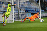 Southend United goalkeeper Daniel Bentley saves low down during the Sky Bet League 1 match between Coventry City and Southend United at the Ricoh Arena, Coventry, England on 31 August 2015. Photo by Simon Davies.