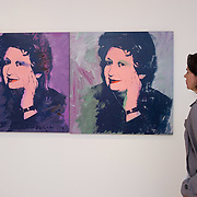 """VENICE, ITALY - MAY 28: A woman looks at a portrait of Ileana Sonnebend by Andy Warhol at the press preview of Ileana Sonnabend """"Un Ritratto Italiano"""" on May 28, 2011 in Venice, Italy. The """"An Italian Portrait"""" Exhibition will be held in dedication to art dealer and collector Ileana Sonnabend, and presentsmore than 60 worksby Italian and international artists such as Pistoletto, Merz, Fontana, Manzoni, Rauschenberg, Koons, Sugimoto, Esser."""