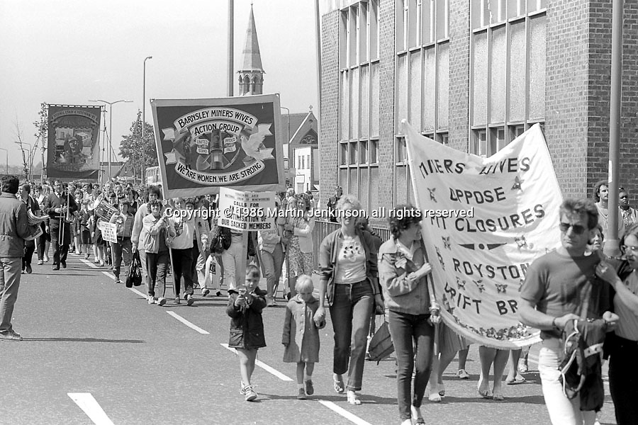 Royston Drift & Barnsley Miners Wives Action Group banners ahead of Sharlston Branch  banner on the 99th Yorkshire Miners Gala. 1986 Doncaster.