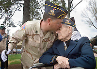 Dennis Lamb, left, kisses his grandfather and World War II veteran Tom Lamb, 87, after Memorial Day ceremonies at the Jackson Town Square. The younger Lamb served with the 3rd Infintry of the U.S. Army during Operation Desert Storm.