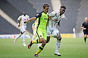 MKDons forward Kieran Agard (14) and Exeter City defender Craig Woodman (3) during the EFL Sky Bet League 2 match between Milton Keynes Dons and Exeter City at stadium:mk, Milton Keynes, England on 25 August 2018.