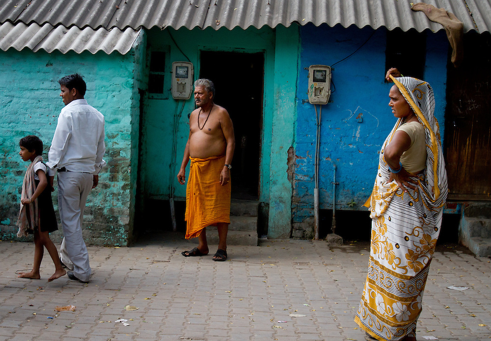 """Villagers look on as two men fight in the street, as we sped by my Tuk Tuk driver informed me, """"today is payday, people like to drink."""" Agra, India"""