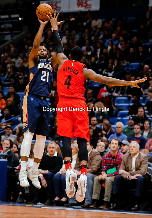 Jan 12, 2018; New Orleans, LA, USA; New Orleans Pelicans forward Darius Miller (21) shoots over Portland Trail Blazers forward Maurice Harkless (4) during the first quarter at the Smoothie King Center. Mandatory Credit: Derick E. Hingle-USA TODAY Sports