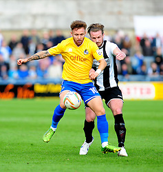 Bristol Rovers' Matty Taylor is challenged by Dorchester Town's Jamie Gleeson - Photo mandatory by-line: Neil Brookman/JMP - Mobile: 07966 386802 - 25/10/2014 - SPORT - Football - Dorchester - The Avenue Stadium - Dorchester Town v Bristol Rovers - FA Cup Qualifying with Budweiser