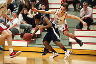 The boys basketball game between the Mount Mansfield Cougars and the Champlain Valley Union Redhawks at CVU High School on Thursday night January 21, 2016 in Hinesburg, Vermont.
