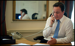 The Prime Minister David Cameron appointing new Ministers on the phone in his office inside Number 10 Downing street, May 13, 2010.  Photo By Andrew Parsons/i-Images