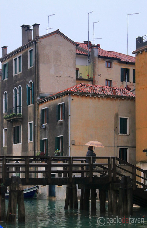 A wooden bridge at Rio della Sensa, a canal in the Sestiere of Cannaregio in Venice, Italy