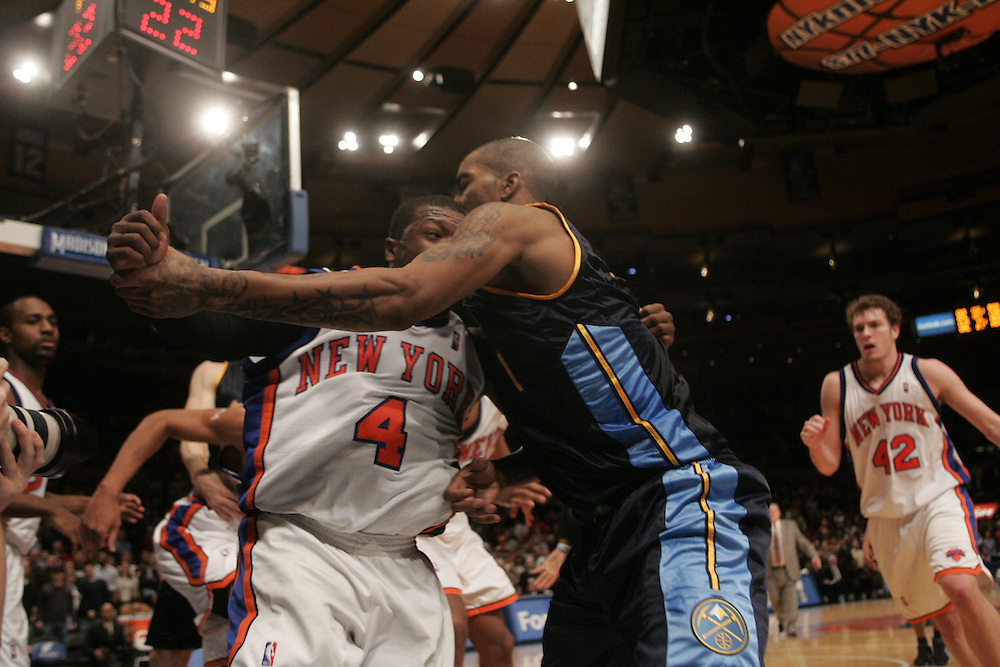 Nate Robinson of the New York Knicks and J.R. Smith of the Denver Nuggets Fight  at Madison Square Garden, New York on Saturday  16 December 2006. (Andrew Gombert for The New York TImes)