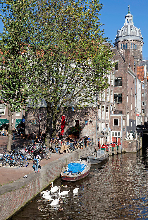 Amsterdam, Holland:  Sunny Sunday afternoon on the Oudezijds Voorburgwal, one of the colorful waterways in Amsterdam's Old Town.
