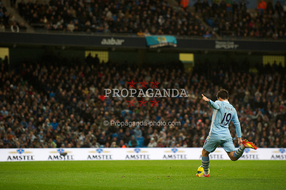 MANCHESTER, ENGLAND - Saturday, December 3, 2011: Manchester City's goal-scorer Samir Nasri shoots a free-kick towards the Norwich City goal during the Premiership match at City of Manchester Stadium. (Pic by David Rawcliffe/Propaganda)