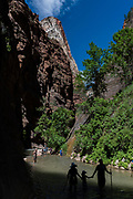A family walks out of The Narrows in Zion National Park on June 10, 2016.