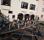People sitting drinking outside The Anchor pub, Cambridge, England