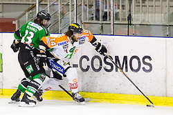 06.01.2015, Hala Tivoli, Ljubljana, SLO, EBEL, HDD Telemach Olimpija vs Moser Medical Graz 99ers, 36. Runde, in picture Luke Walker (Moser Medical Graz 99ers, #14) and David Planko (HDD Telemach Olimpija, #23) during the Erste Bank Icehockey League 36. Round between HDD Telemach Olimpija and Moser Medical Graz 99ers at the Hala Tivoli, Ljubljana, Slovenia on 2015/01/06. Photo by Morgan Kristan / Sportida