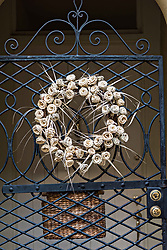 December 21, 2017 - Charleston, South Carolina, United States of America - A wrought iron gate with a palmetto rose Christmas wreath at a historic home on Tradd Street in Charleston, SC. (Credit Image: © Richard Ellis via ZUMA Wire)