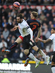 Reading Pavel Pogrebnayak battles with Derby Richard Keogh, Derby County v Reading, FA Cup 5th Round, The Ipro Stadium, Saturday 14th Febuary 2015