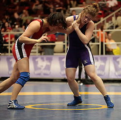 London, Ontario ---2013-03-02---  Natasha Chang of Brock takes on Larrissa Dalleva of Western in the women's 63 KG bronze medal match at the 2012 CIS Wrestling Championships in London, Ontario, March 02, 2013. .GEOFF ROBINS/Mundo Sport Images