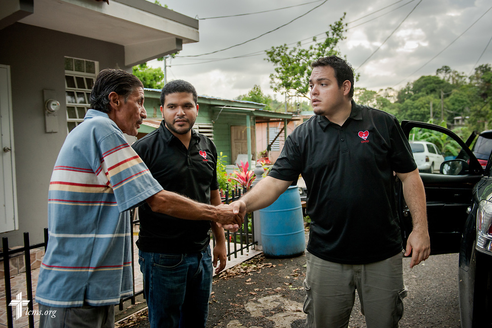 Evangelist William Torres from the Casa de Amparo y Respuesta a Desastre (CARD), or House of Refuge and Mercy Response mercy center, along with the Rev. Gustavo Maita, pastor of Iglesia Luterana Principe de Paz (Prince of Peace Lutheran Church), Mayagüez, Puerto Rico, say goodbye to a resident of the community who was affected by Hurricane Maria on Tuesday, April 17, 2018 in Mayagüez. LCMS Communications/Erik M. Lunsford
