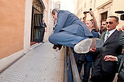 2013/04/19 Roma, nella foto il senatore PDL Maurizio Gasparri scavalca una transenna per raggiungere i colleghi di partito per la riunione del gruppo parlamentare.<br /> Rome, in the picture PDL Senator Maurizio Gasparri crosses a barrier to reach the party colleagues for the meeting of the parliamentary group - &copy; PIERPAOLO SCAVUZZO