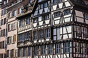 Traditional medieval architecture of canalside buildings along the Navigation Channel in the old part of Strasbourg, Alsace, France