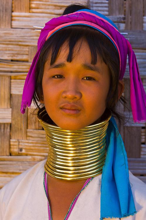 Young long necked Padaung tribe woman wearing neck rings, Nyaungshwe, Shan State, Myanmar, Burma