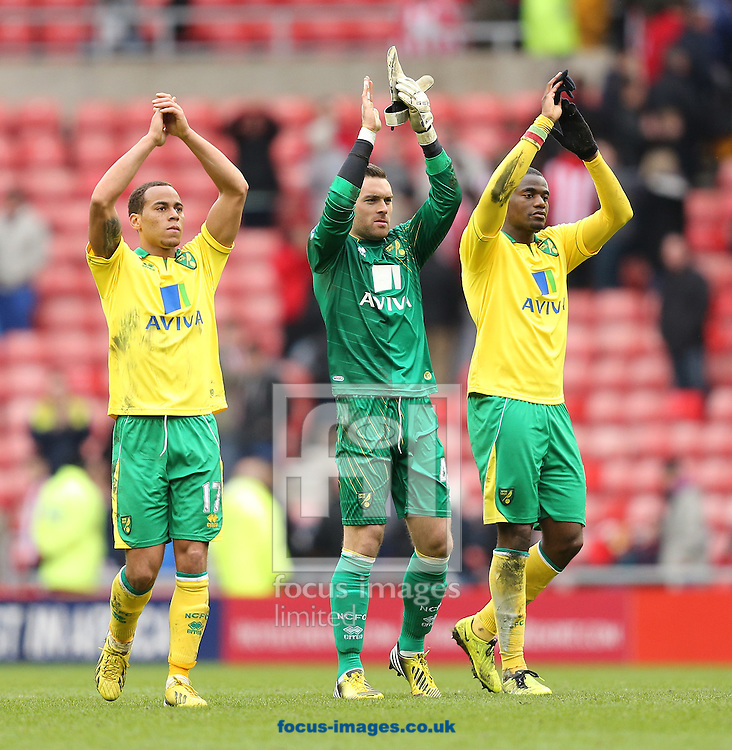Picture by Paul Gaythorpe/Focus Images Ltd +447771 871632.17/03/2013.Norwich City players Elliott Bennett, Lee Camo and Sebastien Bassong applaud the travelling Norwich fans after the Barclays Premier League match at the Stadium Of Light, Sunderland.