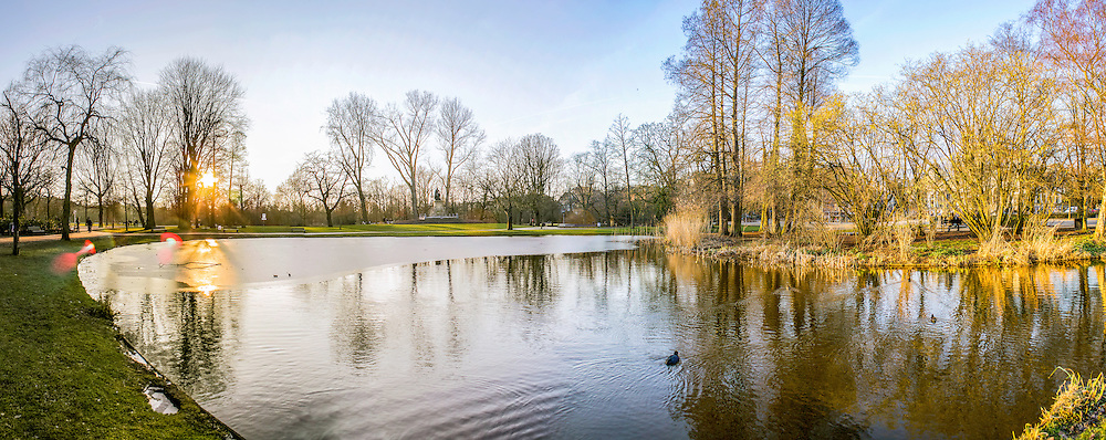 """Pond panoramic landscape photo in Vondelpark, Amsterdam. Is a public urban park of 47 hectares (120 acres), opened in 1865 and originally named the """"Nieuwe Park"""" and is a favorite place for rest and walking to residents and tourists. Yearly, the park has around 10 million visitors."""