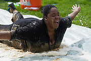 Kateri Dover slides down the slip 'n slide filled with soap and water after completing the Race for a Reason Mud Run Saturday, April 27, 2013.  The course included a four-mile run up to the old Army ROTC Course at the Ridges, through the Radar Hill Trail and back to Tail Great Park across from Peden Stadium. Race for a Reason, Race 4 A Reason, Annual Events, Events, Students, Faculty & Staff