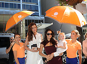 IMAGE DISTRIBUTED FOR ACCUWEATHER -  Ireland Baldwin, Hilaria Baldwin and Carmen Baldwin are shaded from the hot summer sun by the AccuWeather MinuteCast street team at New York Fashion Week, on Tuesday, Sept. 15, 2015. The AccuWeather MinuteCast Street Team is at it again helping Fashion Week attendees stay stylish and one-step ahead of any possible precipitation. (Photo by Diane Bondareff/Invision for AccuWeather/AP Images)