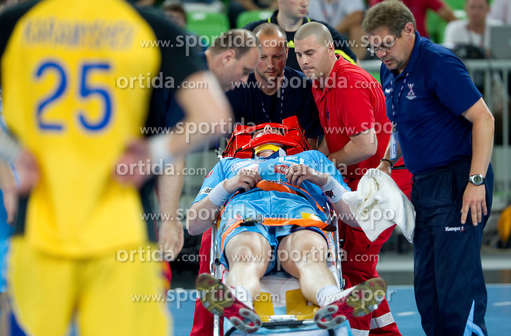 Matej Gaber of Slovenia injured during handball match between National teams of Slovenia and Ukraine of 2012 EHF Men's European Championship Play-off, on June 12, 2011 in  Arena Stozice, Ljubljana, Slovenia. Slovenia defeated Ukraine 43-32 and qualified to EURO Serbia 2012 (Photo By Vid Ponikvar / Sportida.com)