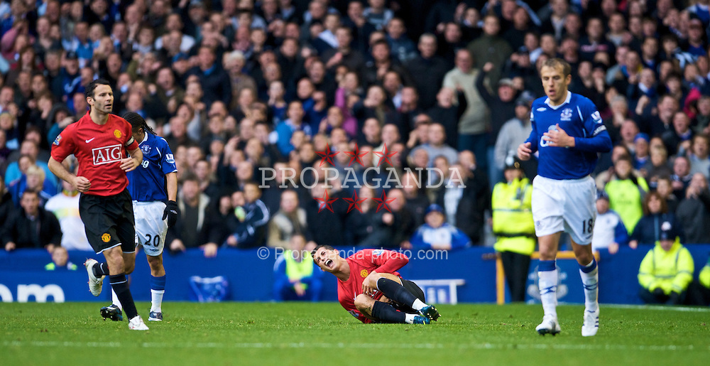 LIVERPOOL, ENGLAND - Saturday, October 25, 2008: Manchester United's Christian Ronaldo pretends to be injured after another spectacular dive during the Premiership match against Everton at Goodison Park. (Photo by David Rawcliffe/Propaganda)