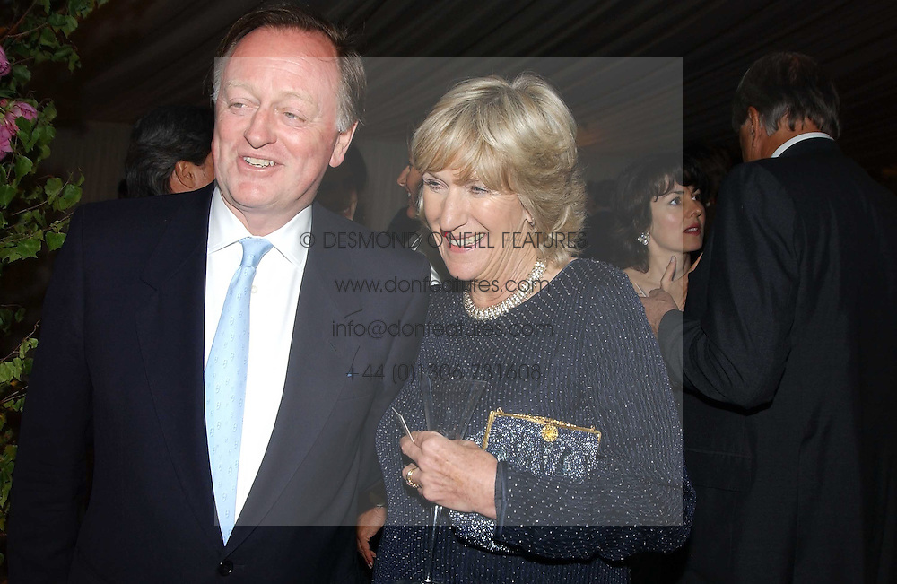 ANDREW PARKER BOWLES and his former sister in law ANNABEL ELLIOT at the Cartier Chelsea Flower Show dinat the annual Cartier Flower Show Diner held at The Physics Garden, Chelsea, London on 23rd May 2005.<br /><br />NON EXCLUSIVE - WORLD RIGHTS