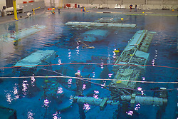 Stock photo of training equipment submerged underwater at the NASA Neutral Buoyancy Lab in Houston Texas