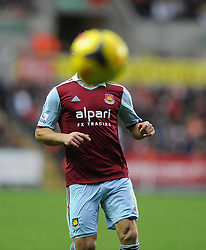 a ball hides the face of West Ham United's Razvan Rat - Photo mandatory by-line: Joe Meredith/JMP - Tel: Mobile: 07966 386802 27/10/2013 - SPORT - FOOTBALL - Liberty Stadium - Swansea - Swansea City v West Ham United - Barclays Premier League
