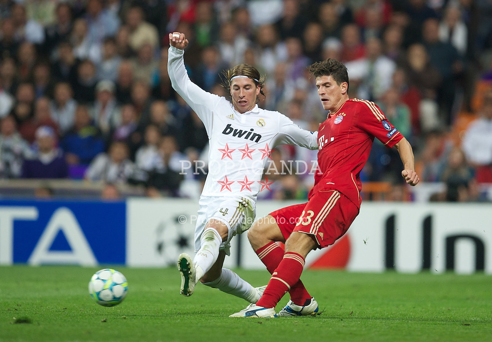 MADRID, SPAIN - Wednesday, April 25, 2012: Real Madrid's Sergio Ramos in action against FC Bayern Munchen's Mario Gomez during the UEFA Champions League Semi-Final 2nd Leg match at the Estadio Santiago Bernabeu. (Pic by David Rawcliffe/Propaganda)