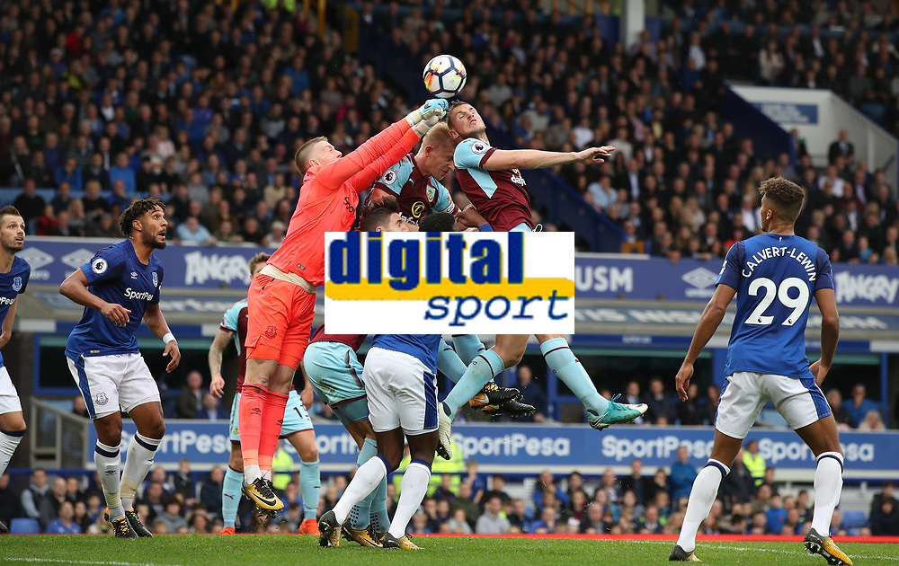 Football - 2017 / 2018 Premier League - Everton vs. Burnley<br /> <br /> Jordan Pickford of Everton punches clear from Chris Wood of Burnley at Goodison Park.