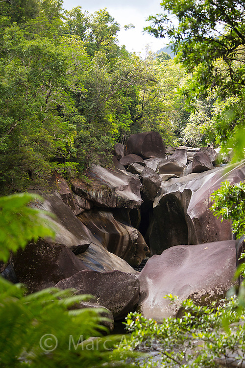 Granite boulders and river bed surrounded by tropical rainforest. Located near Babinda, Wooroonooran National Park, Queensland, Australia