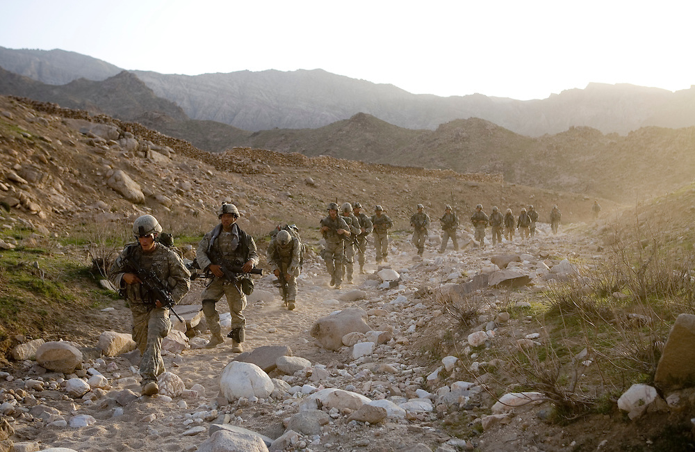 Members of the 82nd Airborne hunt for Taliban in a remote mountain region of Kandahar province, Afghanistan on Sunday, March 25, 2007.
