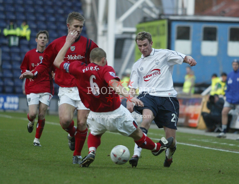 PRESTON, ENGLAND - SATURDAY JANUARY 8th 2005: Preston North End's Joe O'Neill and West Bromwich Albion's Darren Purse during the FA Cup 3rd Round match at Deepdale. (Pic by Paul Ellis/Propaganda)