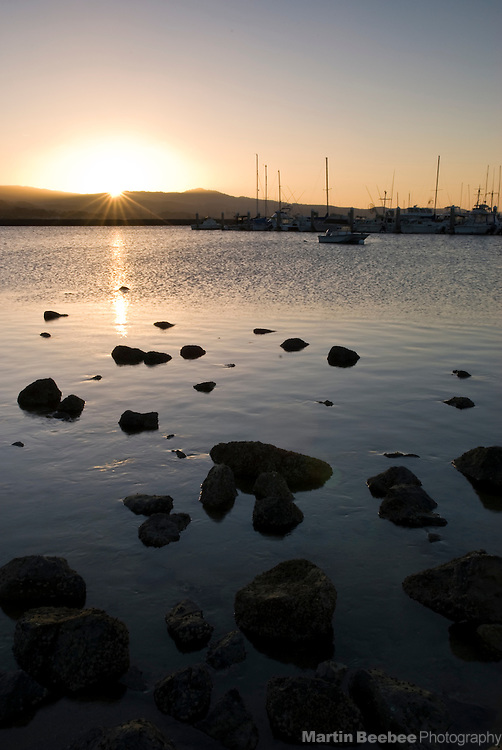 Sunrise over fishing boats in Pillar Point Harbor, Half Moon Bay, California