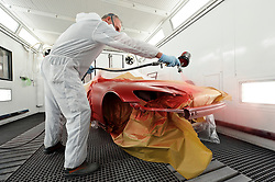 Erik van Dorp, Technical Specialist at AkzoNobel paints a car shell at the AkzoNobel Car Refinishes Instruction Center, (CRIC) in Sassenheim, the Netherlands, Wednesday, Dec. 22, 2010. Akzo Nobel NV, the world's biggest paint maker, reported a 21 percent increase in third quarter net income to 238 million euros. (Photo © Jock Fistick)