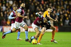 Jack Grealish of Aston Villa is challenged by Dave Edwards of Wolverhampton Wanderers - Mandatory by-line: Dougie Allward/JMP - 14/01/2017 - FOOTBALL - Molineux - Wolverhampton, England - Wolverhampton Wanderers v Aston Villa - Sky Bet Championship
