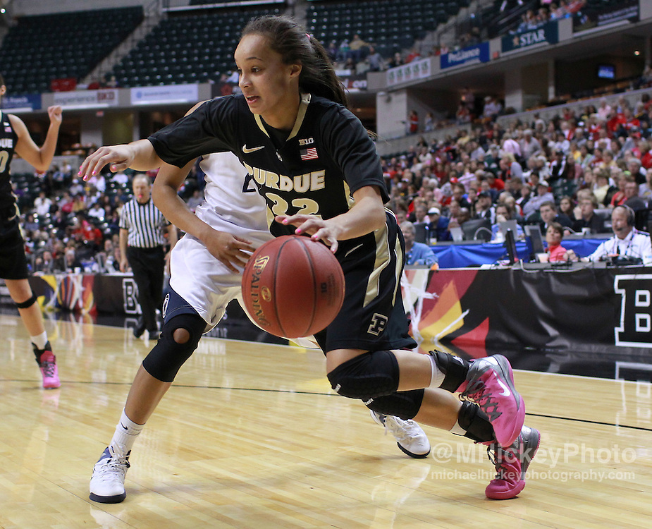 March 03, 2012; Indianapolis, IN, USA;  Purdue Boilermakers guard KK Houser (22) drives the ball along the baseline against the Penn State Lady Lions during the semifinals of the 2012 Big Ten Tournament at Bankers Life Fieldhouse. Mandatory credit: Michael Hickey-US PRESSWIRE