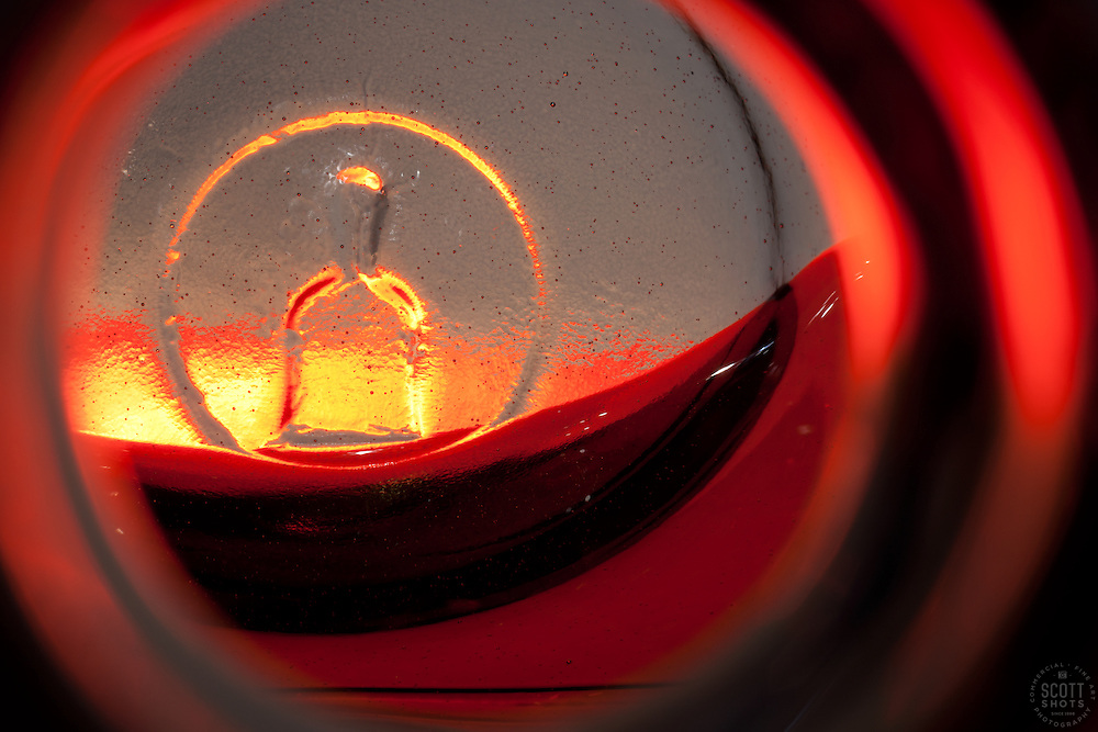 """Beauty at the Bottom: Tequila Sunrise 4"" - This is a photograph of a tequila bottle, shot right down inside the mouth of the bottle."