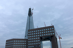 UK ENGLAND LONDON 20DEC11 - The Shard skyscraper under construction seen behind No. London Bridge building in Southwark, London.....jre/Photo by Jiri Rezac....© Jiri Rezac 2011